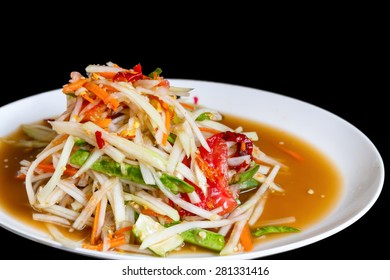 spicy papaya salad with black background