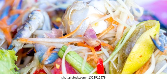 spicy papaya salad with pickled horse crab