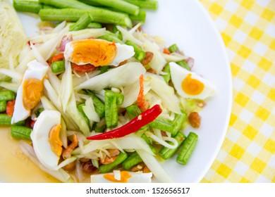Spicy papaya salad with salty eggs