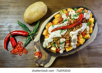SPICY POTATO SKILLET - Rosemary seasoned crispy potato, topped with pepperoncini, cheese sauce, and your choice from chili meat