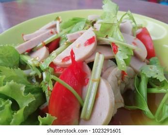 Spicy preserved pork sausage salad , Thai food