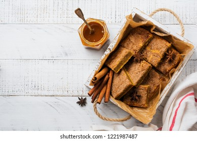 Spicy Pumpkin Сbars Blondie Squares with Cinnamon, Anise and Caramel. Traditional English Dessert. Top view.