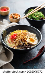 Spicy ramen bowl with noodles, chicken, boiled egg and vegatables