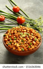 Spicy roasted chickpeas with exotic spics  and herbs- Indian vegetarian curry background.