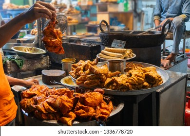 Spicy roasted tandoori chicken , chicken kabab, prepared for sale at evening as street food in Old Delhi market. It is famous for spicy Indian non vegetarian street foods. It is famous tourist spot.