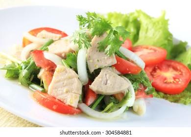 Spicy salad of white pork sausage, Popular Thai food.