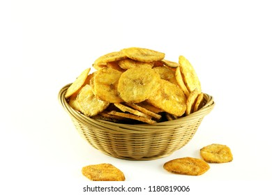 spicy salty banana chips or wafers with herbs masala traditional indian gujarati snack isolated on a white background