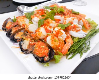 Spicy Seafood Salad in white plate.