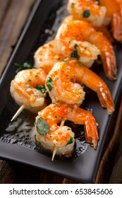 spicy shrimp skewers served on plate