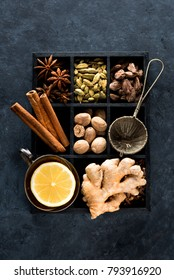 Spicy spices, lemon and ginger in a wooden box