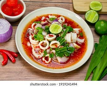 Spicy squid salad, Thai cuisine Yum traditional spicy hot squid.