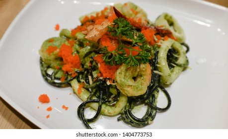 Spicy squid-ink spaghetti with seafood