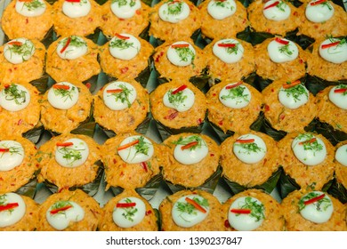 Spicy steamed fish with red curry paste or Hor Mok, topping with coconut milk and chilli. Traditional Thai food freshly cooked for sale in the market. Street food in Thailand.