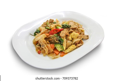 Spicy stir fried flat noodle with pork and basil in white dish isolated on white background, Thai Food