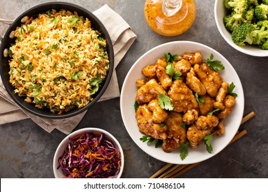 Spicy sweet and sour general tso chicken with fried rice and purple cabbage overhead shot