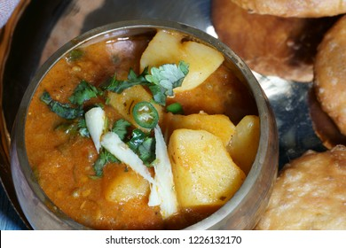 Spicy and tangy Aalu or potato sabji or curry served with Khasta