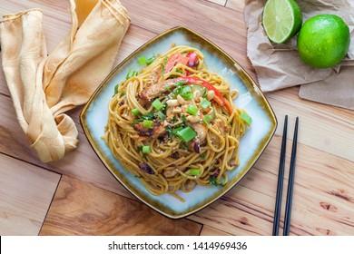 Spicy Thai chicken peanut butter lo mein noodles with sesame seeds