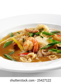 Spicy Thai Seafood Soup. Isolated on White