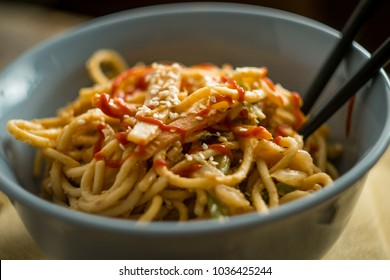 Spicy Thai vegetable peanut butter lo mein noodles with sesame seeds
