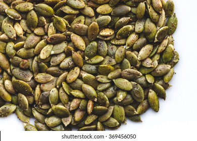 Spicy Toasted Pumpkin Seeds on White Background