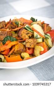 spicy tofu and vegetable stir fry dish closeup