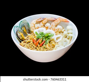 spicy tom yum noodles seafood served with Shrimp, Squid, Mussels and Straw mushroom in white bowl 45 degree angle view on black background