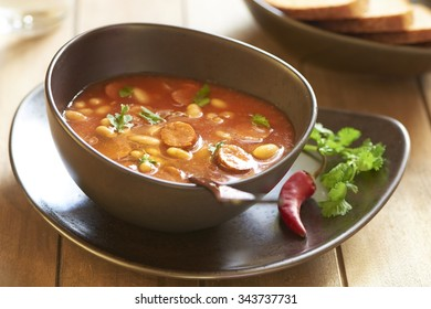 Spicy tomato soup with beans and smoked sausage