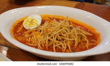 Spicy tteokbokki in white bowl