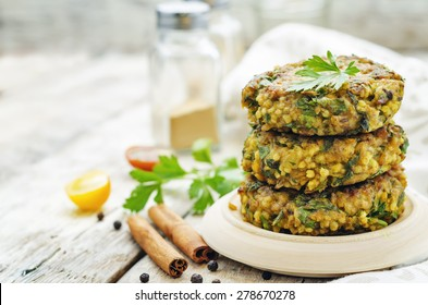 spicy vegan curry burgers with millet, chickpeas and herbs. the toning. selective focus