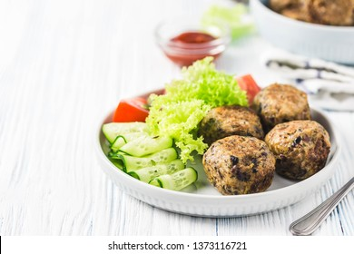 Spicy vegetarian black bean meatballs. Selective focus, space for text.