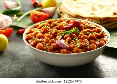 Spicy vegetarian dish - channa masala or chickpeas curry -  famous north Indian recipes.