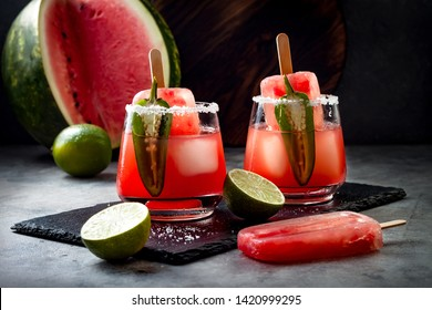 Spicy watermelon popsicle margarita cocktail with jalapeno and lime. Mexican alcoholic drink for Cinco de mayo party