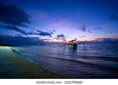 spider boat with a beautiful sky in the early morning on the bali beach