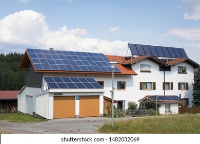 Spiegelau, Bavaria / Germany - July 18 2019: Solar pv  and thermal panels delivering clean energy and heating to a house in summer