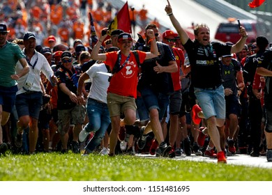 Spielberg, Austria. 01/07/2018. F1 Grand Prix of Austria. F1 World Championship 2018. Supporters of Max Verstappen celebrating the victory at the end of the race.