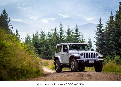 Spielberg / Austria - 07/17/2018: The 2019 Jeep Wrangler JL Sahara off-road with mountains in the background