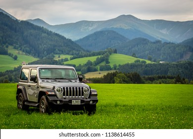 Spielberg / Austria - 07/17/2018: The new JL Model Jeep Wrangler off-road with mountains in the background