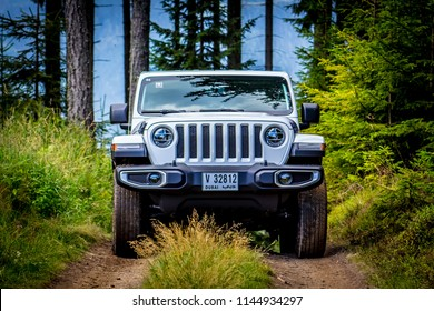 Spielberg / Austria - 07/17/2018: The new JL Jeep Wrangler with Dubai licence plates off-roading in a forest