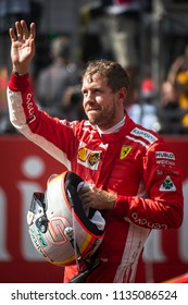Spielberg, Austria - July 1, 2018: Scuderia Ferrari's German driver Sebastian Vettel waves after the Austrian Formula 1 Grand Prix race at the Red Bull Ring, in Spielberg, Austria on July 1, 2018.