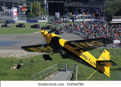 Spielberg, Austria- September 6, 2015: Race plane and crowd of people at Red Bull Air Race World Championship in Red Bull Ring, Austria on September 6, 2015.