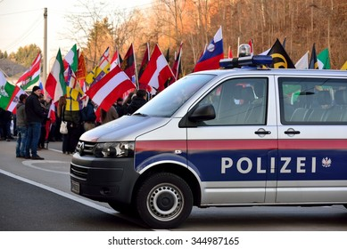 Spielfeld, Austria - November 28, 2015: Police car in front of demonstrators. International blockade by 1000 activists of the Austrian identitarian movement of the border crossing near Spielfeld.