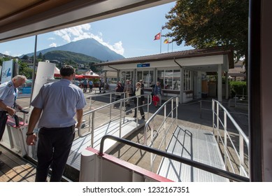 Spiez/Switzerland - August 25 2015: Disembarking from the ship at Spiez pier. Spiez is a town and municipality on the shore of Lake Thun in the Bernese Oberland region of the Swiss canton of Bern.