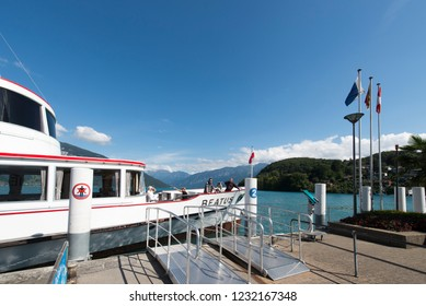 Spiez/Switzerland - August 25 2015: Passenger boat at Spiez pier. Spiez is a town and municipality on the shore of Lake Thun in the Bernese Oberland region of the Swiss canton of Bern.