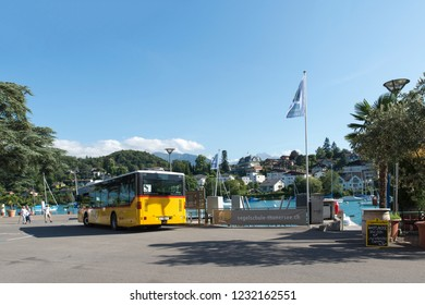 Spiez/Switzerland - August 25 2015: Postal bus in Spiez. Spiez is a town and municipality on the shore of Lake Thun in the Bernese Oberland region of the Swiss canton of Bern.