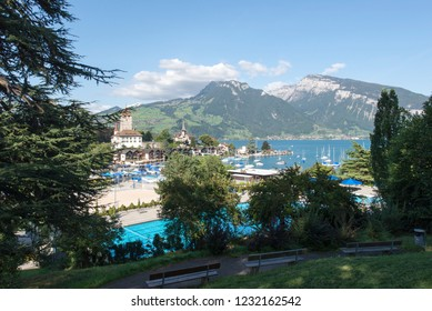 Spiez/Switzerland - August 25 2015: Seegarten Marina seen from the train station. Spiez is a town and municipality on the shore of Lake Thun in the Bernese Oberland region of the Swiss canton of Bern.