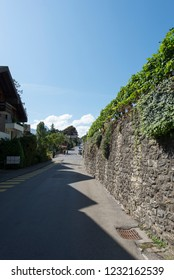 Spiez/Switzerland - August 25 2015: Seestrasse street in Spiez. Spiez is a town and municipality on the shore of Lake Thun in the Bernese Oberland region of the Swiss canton of Bern.