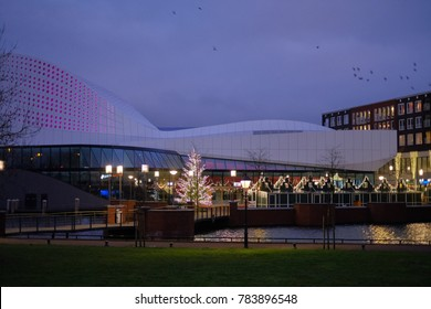 SPIJKENISSE, NETHERLANDS - January 24, 2017 Christmas evening with lights, buildings, apartments and city outdoor urban view of modern real estate homes, stoep theater in Spijkenisse, thy Netherlands