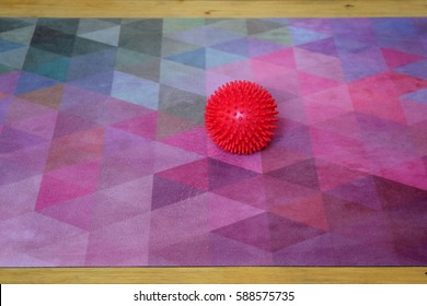 spiky ball on a colorful yoga mat