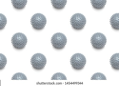 Spiky gray massage ball on white background. For muscle treatment. Pattern design.