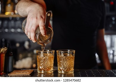 Spill a cocktail. Party. The barman is preparing a cocktail